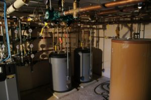 After Image of a clean boiler room with high efficiency boilers installed after gas conversion